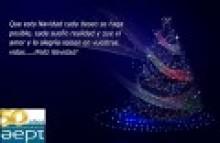 Felicitación navideña: arbol de navidad y texto al uso